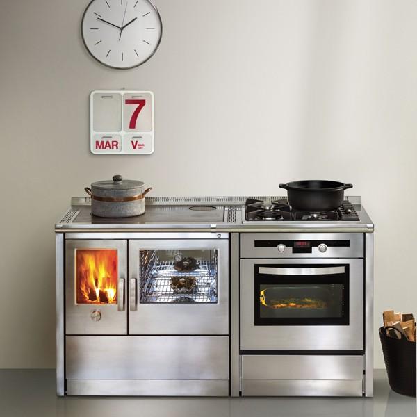 J corradi le cucine a legna per cucinare e riscaldare la - Riscaldare casa in modo economico ...