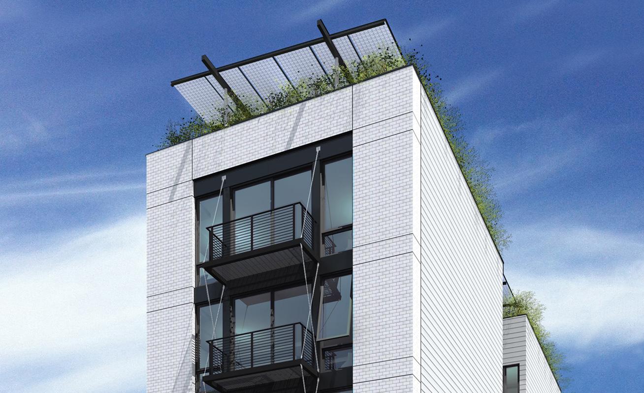 I balconi in acciaio progettati per minimizzare i ponti termici e l'impianto fotovoltaico a tettoia integrato nell'achitettura